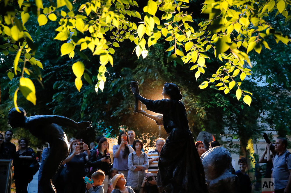 An artist performs during the Living Statues International Festival, in Bucharest, Romania, Tuesday, May 22, 2018. (AP Photo/Vadim Ghirda)