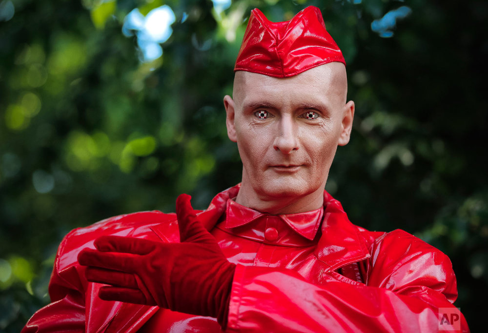Germany's John Man performs his Candy Man act during the Living Statues International Festival, in Bucharest, Romania on Sunday, May 27, 2018. (AP Photo/Vadim Ghirda)