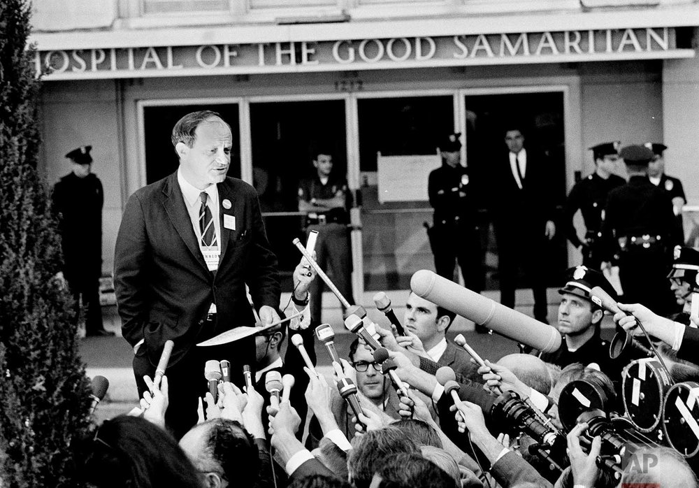 "In this June 5, 1968 photo, Frank Mankiewicz, Sen. Robert F. Kennedy's press secretary, tells a news conference outside Good Samaritan hospital in Los Angeles that Kennedy emerged from three hours of surgery in ""extremely critical condition."" Kennedy died later that day. Associated Press Hollywood reporter Bob Thomas was on a one-night political assignment covering Kennedy's victory celebration in the California presidential primary at the Ambassador Hotel when mayhem unfolded before his eyes. (AP Photo)"