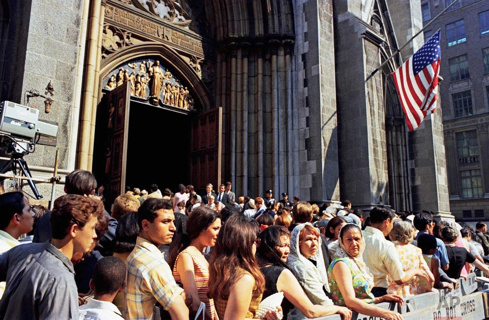 Mourners stand outside of St. Patrick's Cathedral in New York on the day of the funeral for assassinated Sen. Robert F. Kennedy, June 8, 1968.  (AP Photo)