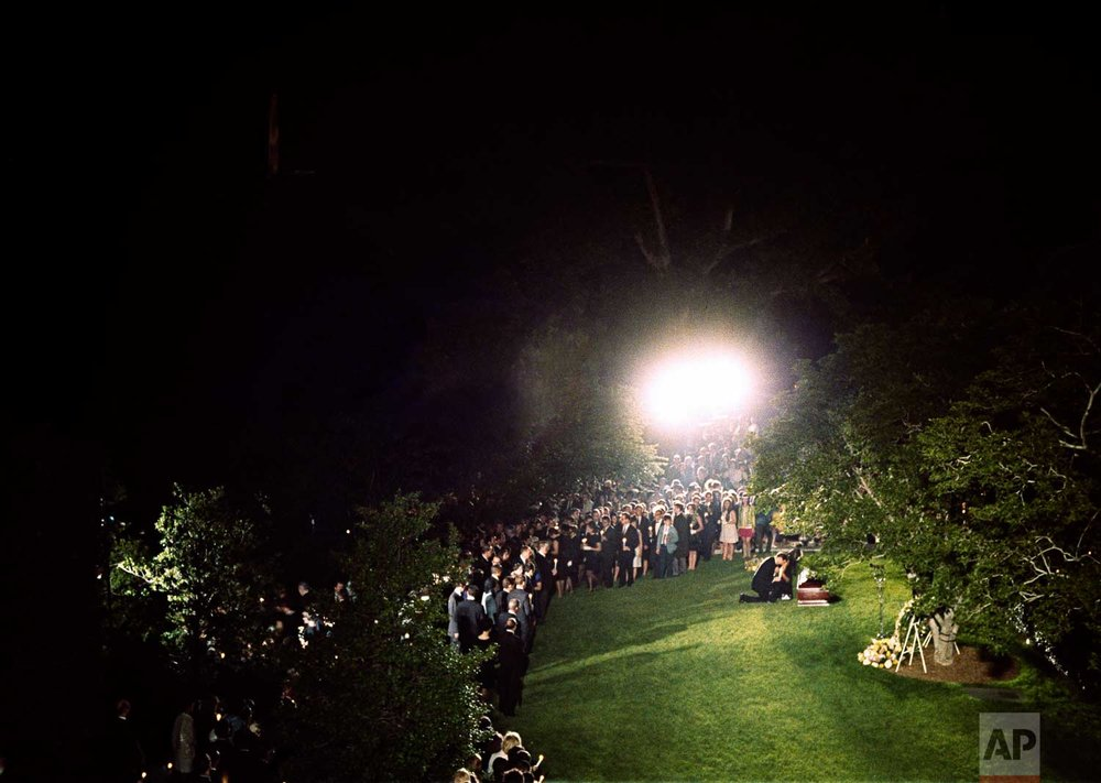 This is a general view of the grave site of the late Sen. Robert F. Kennedy during a rare night time burial service at Arlington National Cemetery in Arlington, Va., June 8, 1968.  (AP Photo)