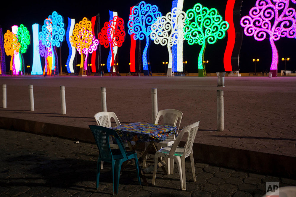 """Tree of Life"" metal sculptures line the lake in Managua, Nicaragua, Friday, May 4, 2018. When protests against a change to Nicaragua's social security system turned confrontational, the favorite targets of the more destructive demonstrators were the so-called ""Trees of Life"" that line some of Managua's main thoroughfares. (AP Photo/Moises Castillo)"