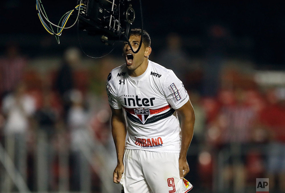 Diego Souza of Brazil's Sao Paulo, celebrates in front of a tv camera after scoring against Argentina's Rosario Central, during a Copa Sudamericana soccer match in Sao Paulo, Brazil, Wednesday, May 9, 2018. (AP Photo/Andre Penner)