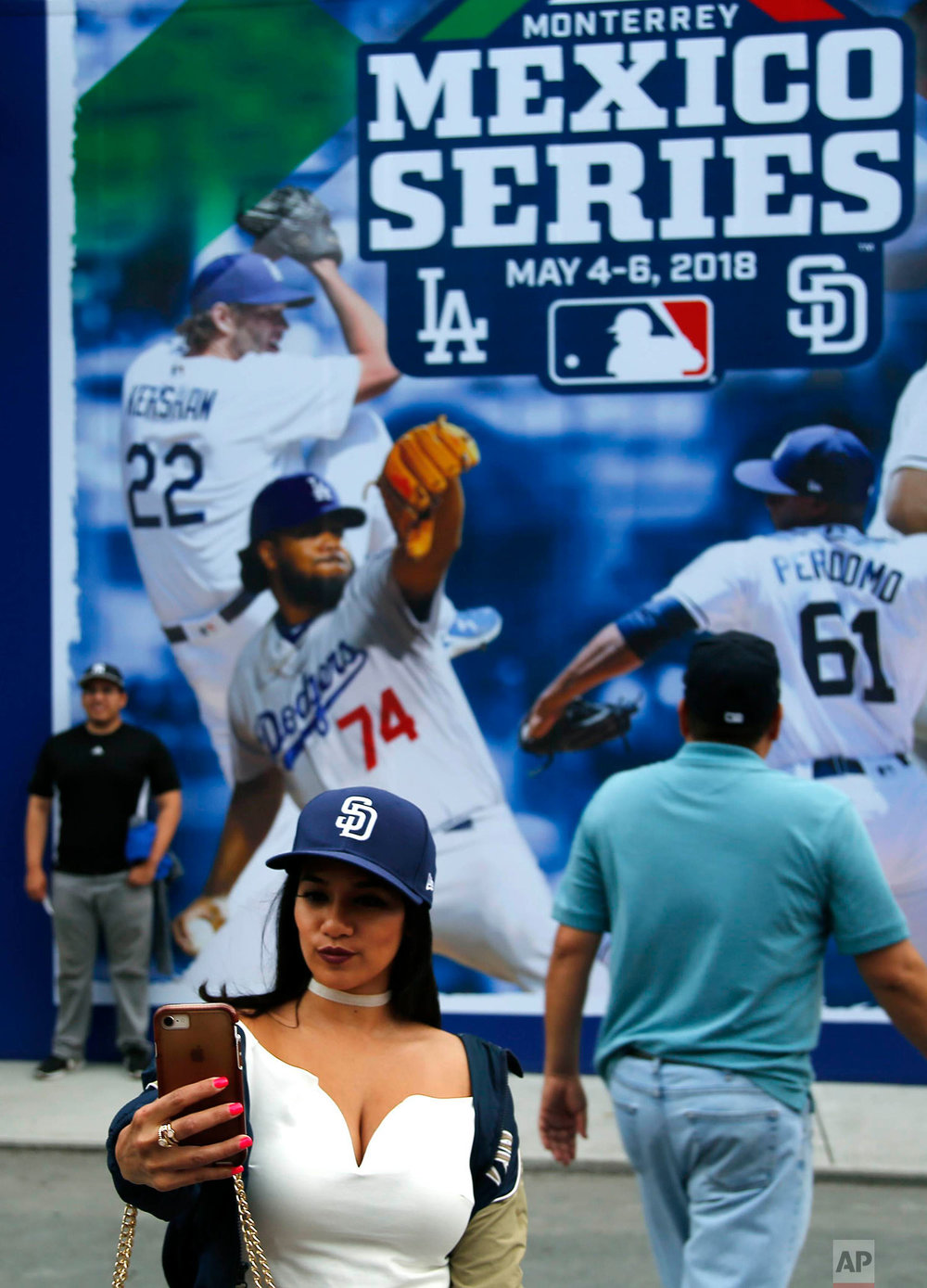 A fan takes a selfie at the stadium before a major league baseball game between the San Diego Padres and Los Angeles Dodgers in Monterrey, Mexico, Friday, May 4, 2018. (AP Photo/ Eduardo Verdugo)