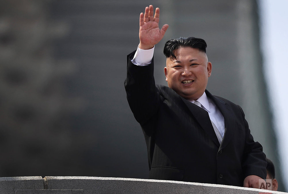 North Korean leader Kim Jong Un waves during a military parade to celebrate the 105th anniversary of the birth of his grandfather, the country's late founder Kim Il Sung, in Pyongyang on April 15, 2017. (AP Photo/Wong Maye-E)