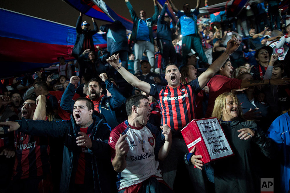 San Lorenzo fans celebrate a goal against Belgrano de Cordoba  in the grandstand in Buenos Aires, Argentina, May 4, 2018. (AP Photo/Rodrigo Abd)