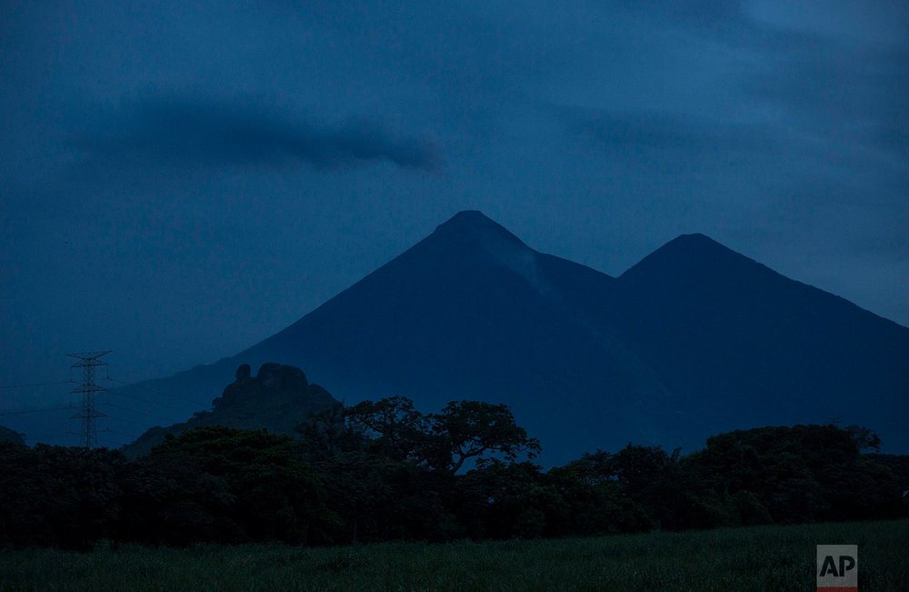 "Ash rises early morning from  the Volcan de Fuego, or ""Volcano of Fire,"" in  El Rodeo, Escuintla, Guatemala, Wednesday, June 6, 2018. (AP Photo/Rodrigo Abd)"