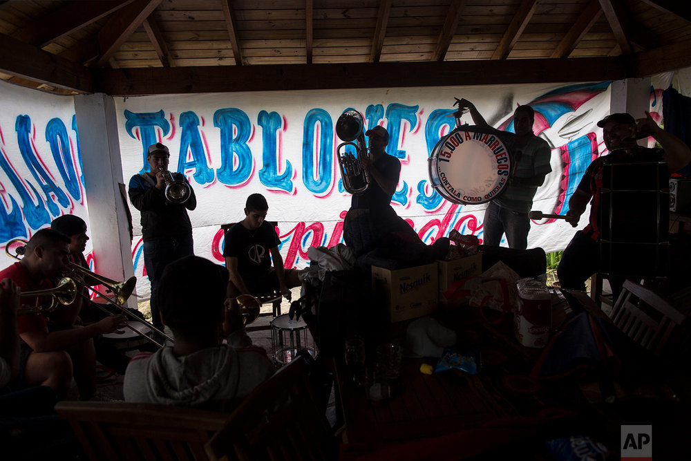 Musicians from the School of Wooden Planks, a name in honor of the wooden bleachers in many stadiums, create new songs for the fans of the San Lorenzo soccer team and Argentina's national team, in Buenos Aires, Argentina, May 1, 2018.  (AP Photo/Rodrigo Abd)
