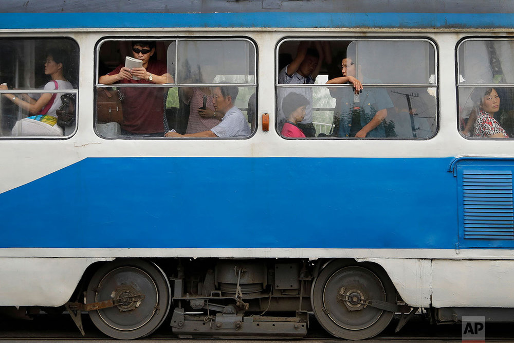 Commuters ride an electric trolley in downtown Pyongyang, North Korea, at the end of a work day on July 28, 2017. (AP Photo/Wong Maye-E)