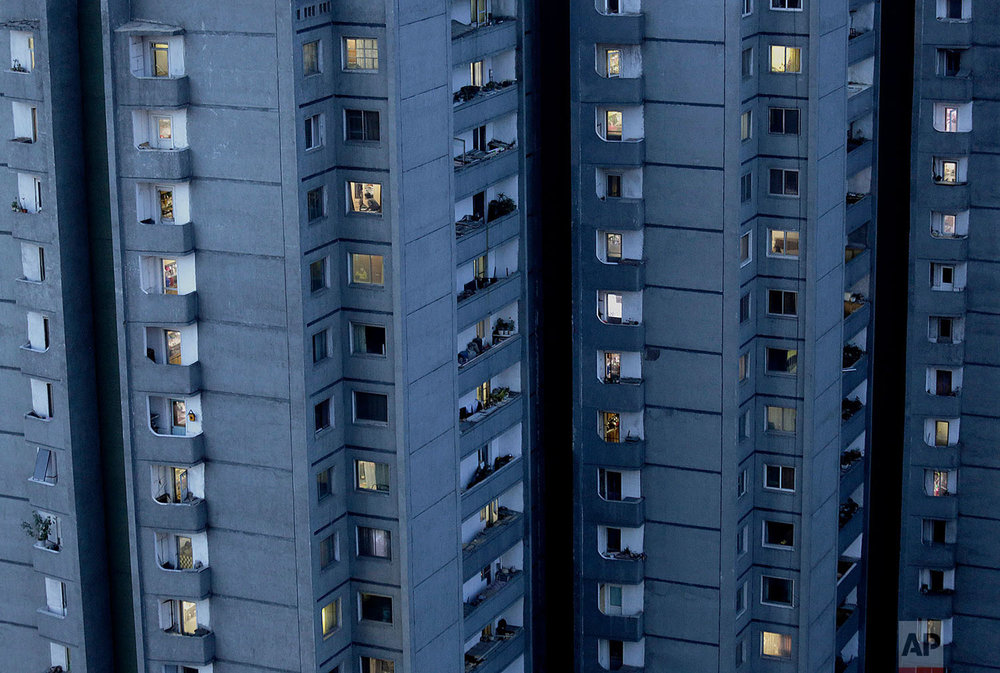 Lights are switched on in occupied apartments as dusk descends in Pyongyang, North Korea, on May 10, 2015. Most of the North Koreans in Pyongyang live in high-rise apartments. (AP Photo/Wong Maye-E)