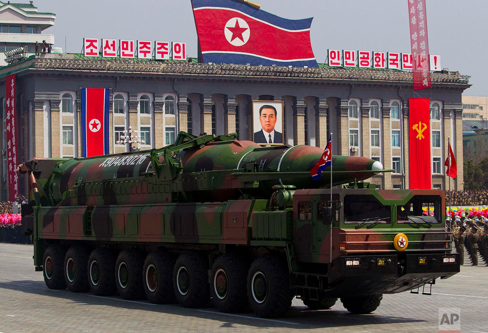 A large 16-wheel truck carries a missile during a massive military parade in Pyongyang's Kim Il Sung Square on April 15, 2012, to celebrate the centenary of the birth of the late North Korean founder Kim Il Sung. (AP Photo/David Guttenfelder)