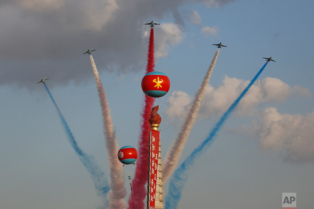Jets fly over the Juche Tower during a parade on Kim Il Sung Square in Pyongyang, North Korea, on Oct. 10, 2015. (AP Photo/Wong Maye-E)