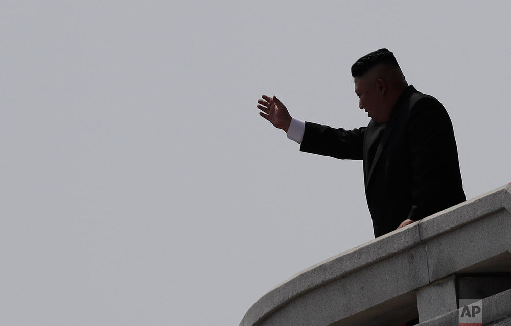 North Korean leader Kim Jong Un waves during a military parade in Pyongyang, North Korea, to celebrate the 105th anniversary of the birth of Kim Il Sung, his grandfather, on April 15, 2017. (AP Photo/Wong Maye-E)