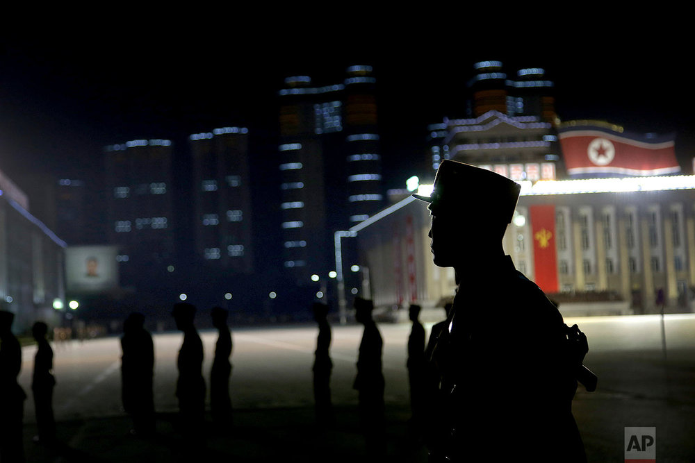 A North Korean soldier is silhouetted on Kim Il Sung Square in Pyongyang on Oct. 10, 2015, following a mass military parade. (AP Photo/Wong Maye-E)