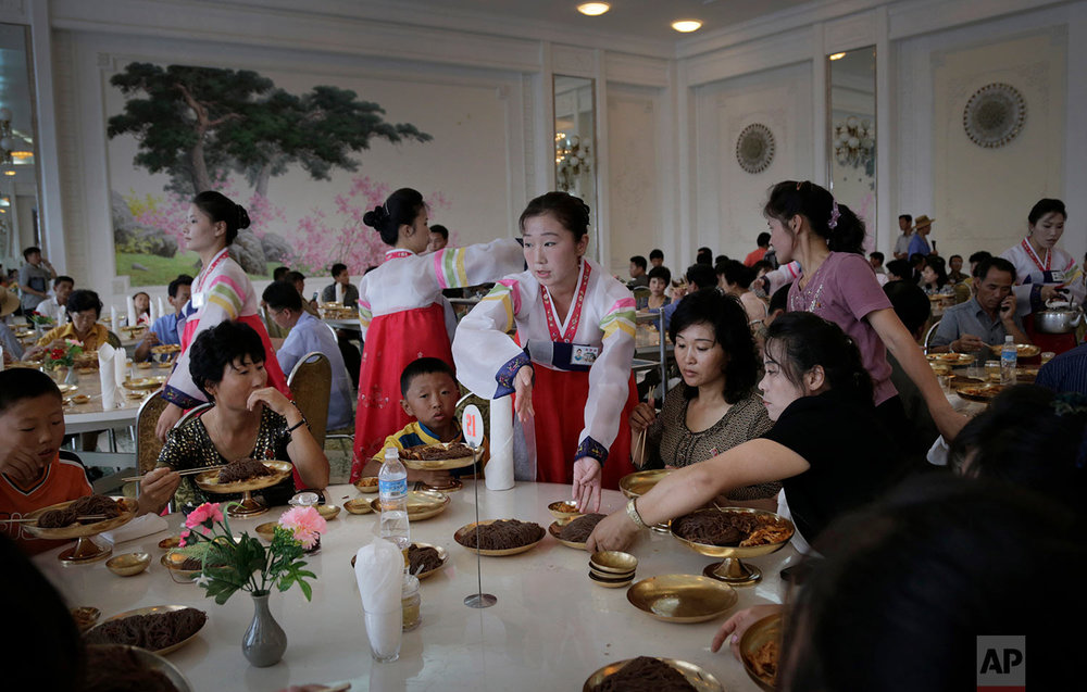 People dine at the Ongnyugwan, a popular noodle restaurant in Pyongyang, North Korea, on Sept. 1, 2014. The restaurant, built in 1960 at the instructions of the late leader Kim Il Sung, claims to serve 10,000 lunches a day. (AP Photo/Wong Maye-E)
