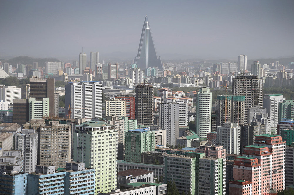 The 105-story pyramid-shaped Ryugyong Hotel towers over residential apartments, forming the skyline of Pyongyang, North Korea, on May 7, 2016. (AP Photo/Wong Maye-E)