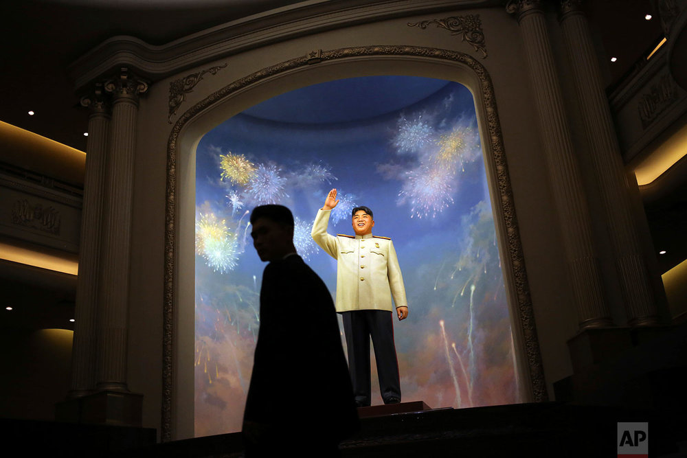 A man is silhouetted against a statue of the late North Korean leader Kim Il Sung at the newly opened Fatherland Liberation War Museum in Pyongyang, North Korea, during a celebration of the 60th anniversary of the Korean War armistice on June 27, 2013. (AP Photo/Wong Maye-E)