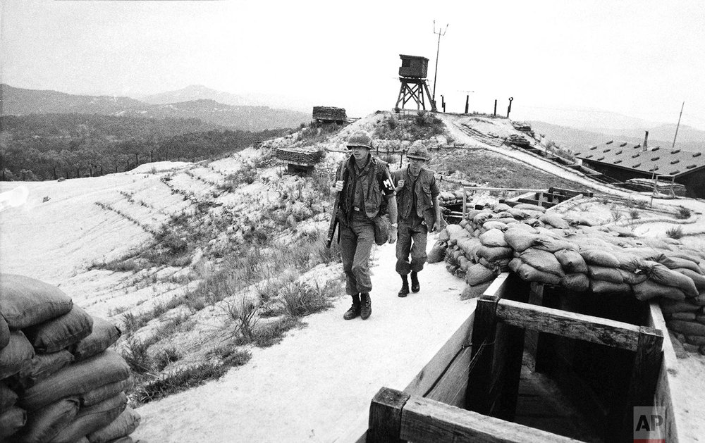 American soldiers patrol along a ridge between observation towers at Ouellette, the northernmost outpost in Korea's Demilitarized Zone manned by U.S. forces, on Sept. 22, 1977. (AP Photo/MD)