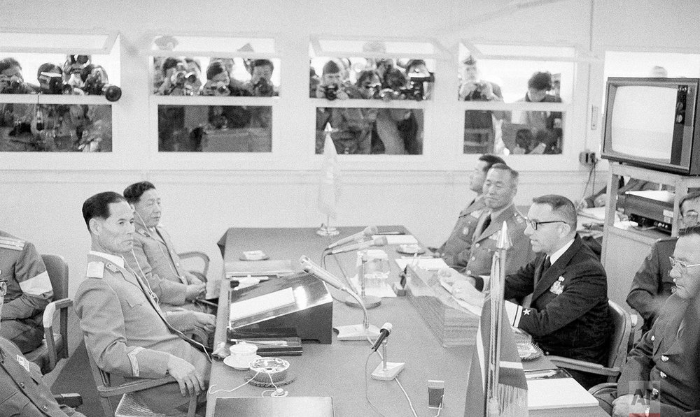 U.S. Vice Admiral Warren Hamm Jr., right, the senior negotiator for the United Nations Command, speaks at the 391st Military Armistice Commission (MAC) meeting at Panmunjom, Korea, on Oct. 27, 1978. Vice Adm. Hamm accused North Korea of digging an underground tunnel in the Demilitarized Zone into South Korea. At left is North Korean army Maj. Gen. Han Ju-Kyong, the North's chief MAC delegate. (AP Photo)