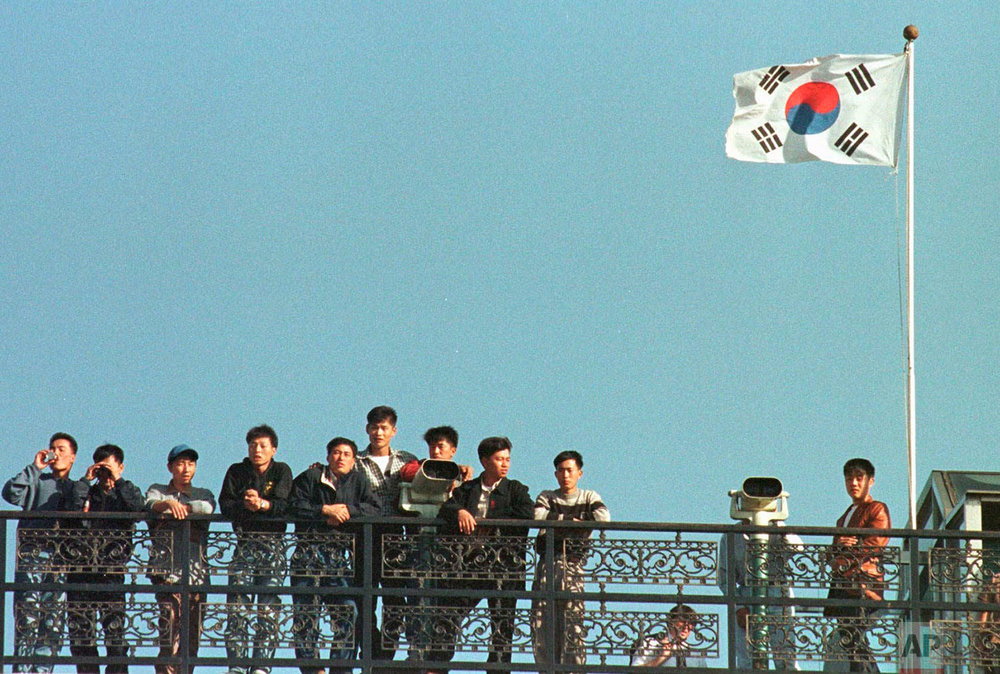 South Korean students look across the Demilitarized Zone between the two Koreas at the guard post of Imjingak, north of Seoul, Friday, Oct. 17, 1997. Earlier that day, North Korean soldiers crossed into the southern half of the buffer zone, seizing two South Korean farmers in a rice field and taking them back to the northern side. The farmers were returned soon afterward. (AP Photo/Yun Jai-hyoung)