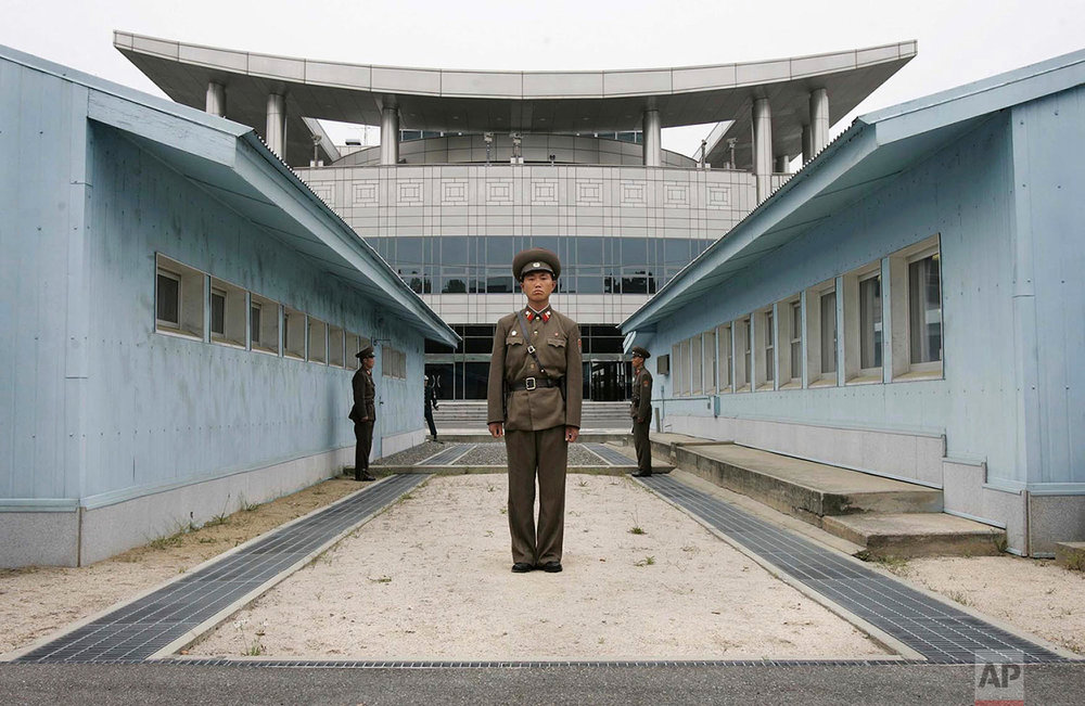 A North Korean soldier stands guard on the north side of the line separating North and South Korea in the border town of Panmunjom on May 19, 2006. (AP Photo/Wally Santana)