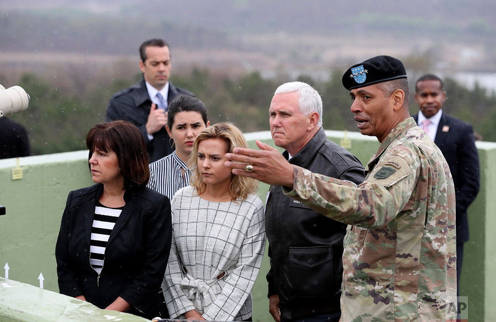 U.S. Gen. Vincent Brooks, right, commander of the United Nations Command, U.S. Forces Korea and Combined Forces Command, briefs U.S. Vice President Mike Pence, as Pence's wife Karen, left, and their daughters Audrey, second from left, and Charlotte, third from left, listen from Observation Post Ouellette in the Demilitarized Zone near the border village of Panmunjom, Korea, on April 17, 2017. (AP Photo/Lee Jin-man)