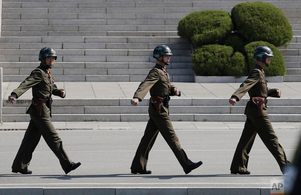 North Korean soldiers march at the border village of Panmunjom in the Demilitarized Zone that divides North and South Korea on April 18, 2018. (AP Photo/Lee Jin-man)