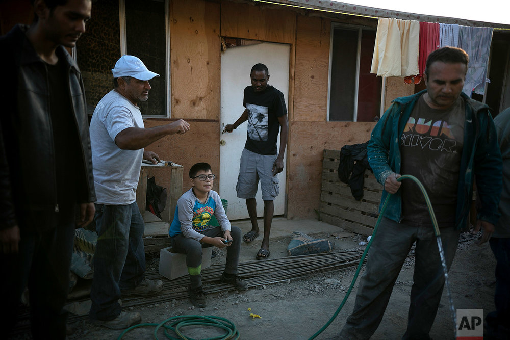 A resident of Little Haiti leaves a house built by a pastor and volunteers in Tijuana, Mexico, May 9, 2018. (AP Photo/Emilio Espejel)