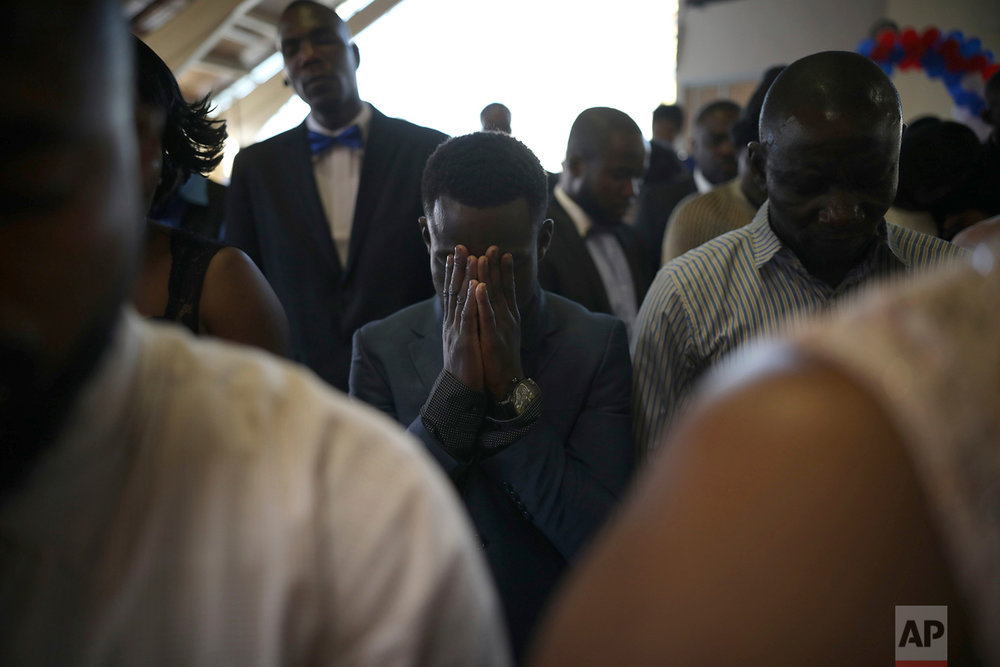 A man prays at the First Baptist Church of Tijuana, Mexico, May 5, 2018, (AP Photo/Emilio Espejel)
