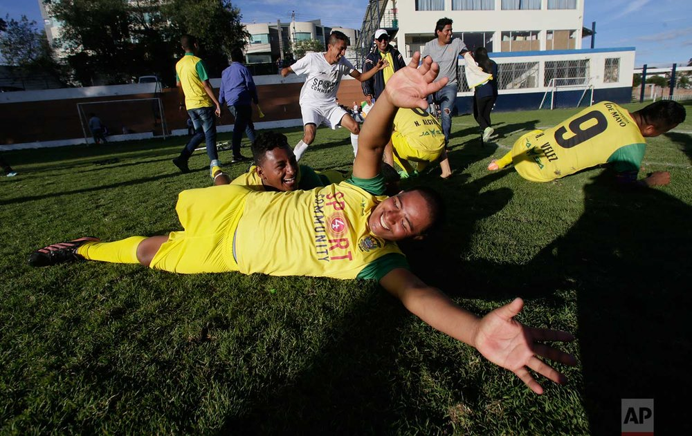In this June 9, 2018 photo, Juan Moran, of El Empalme team, celebrates his team's victory over Fuerzas Armadas and classifying to the next round of the national soccer tournament for players with amputated limbs, in Quito, Ecuador. While the one-legged game is just taking off in Ecuador, it's getting a big boost from the country's president, Lenin Moreno, a wheelchair-bound paraplegic who was a major force for the rights of the disabled around the world as the United Nations' envoy on disability and accessibility in Geneva, Switzerland between 2013 and 2016. (AP Photo/Dolores Ochoa)