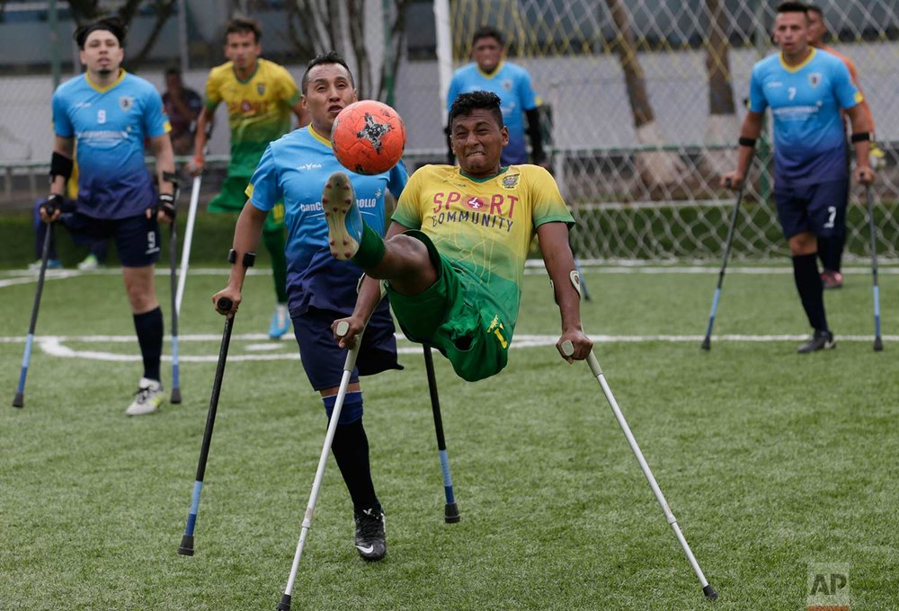 In this June 10, 2018 photo, Rodrigo Ramirez, right, of El Empalme team, controls the ball next to Wilson Tianga, of Android team, during the final game at the national soccer tournament for players with amputated limbs, in Quito, Ecuador. It's the South American nation's second amputee soccer tournament, even though the country's national team didn't qualify for the FIFA World Cup beginning this month in Russia. (AP Photo/Dolores Ochoa)