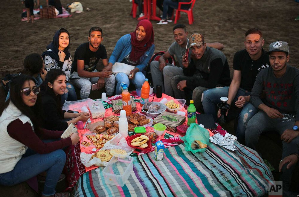 Friends gather to break their fast on the beach in the holy month of Ramadan, Rabat, Morocco, Saturday, June 9, 2018. (AP Photo/Mosa'ab Elshamy)