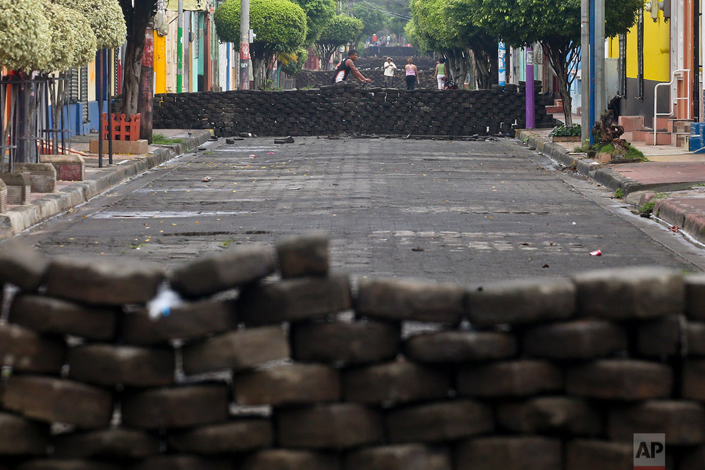 In this June 6, 2018 photo, multiple barricades crated by anti-government protesters, and made of cobblestone, block a street in Masaya, Nicaragua. (AP Photo/Esteban Felix)