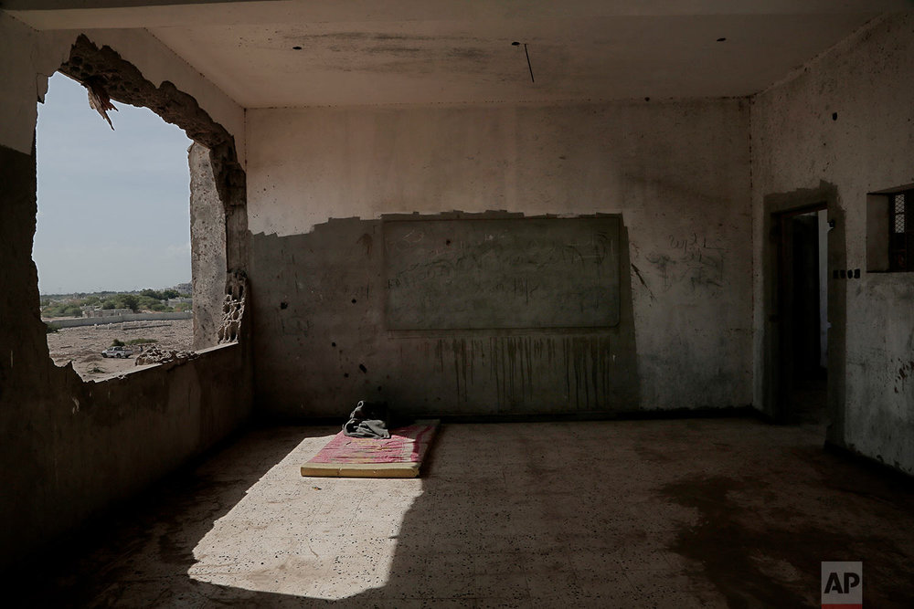 Damage inside a classroom of a school that turned into a camp for displaced persons in Khanfar, Abyan, Yemen. (AP Photo/Nariman El-Mofty)