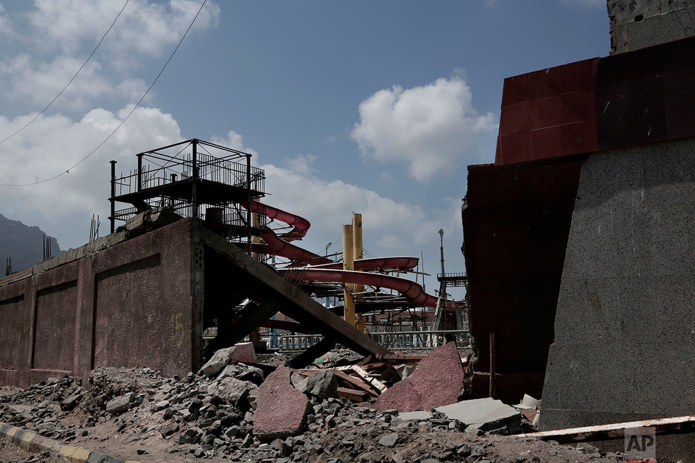This Feb. 17, 2018, photo shows a damaged theme park in Aden, Yemen. The mood is eerie on the mostly empty streets of Aden, Yemen's southern port city and designated seat of government that has suffered three years of civil war. (AP Photo/Nariman El-Mofty)