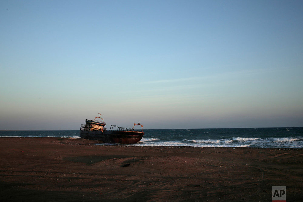 A ship wreck abandoned on the shore from Mocha to Aden in Yemen. On the beach, old pleasure venues also lie empty, broken and deserted due to the civil war here.(AP Photo/Nariman El-Mofty)