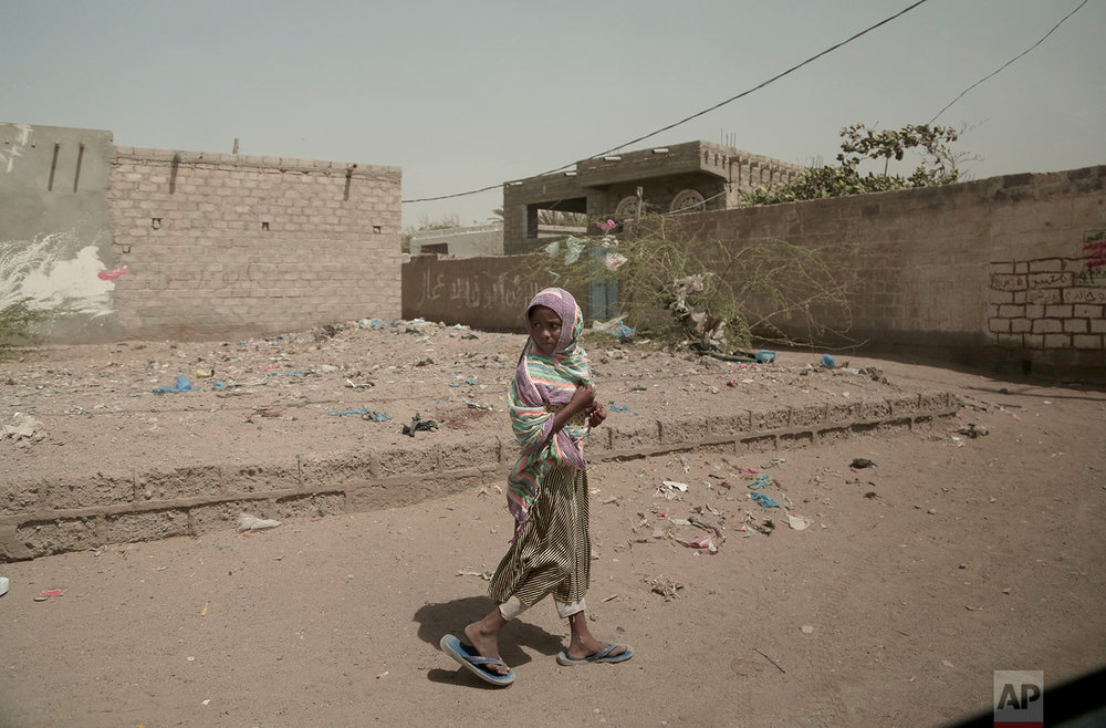 A girl walks alone on a street in al-Khoukha, Yemen. (AP Photo/Nariman El-Mofty)