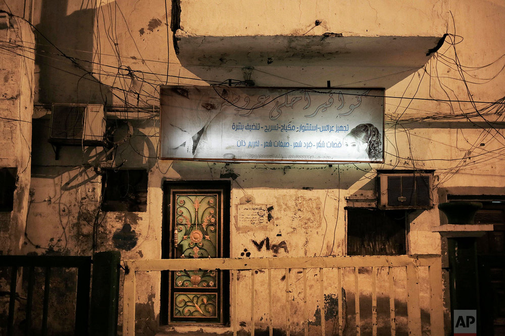Damage and bullet holes from the country's civil war outside a women's hair salon in Aden, Yemen.(AP Photo/Nariman El-Mofty)