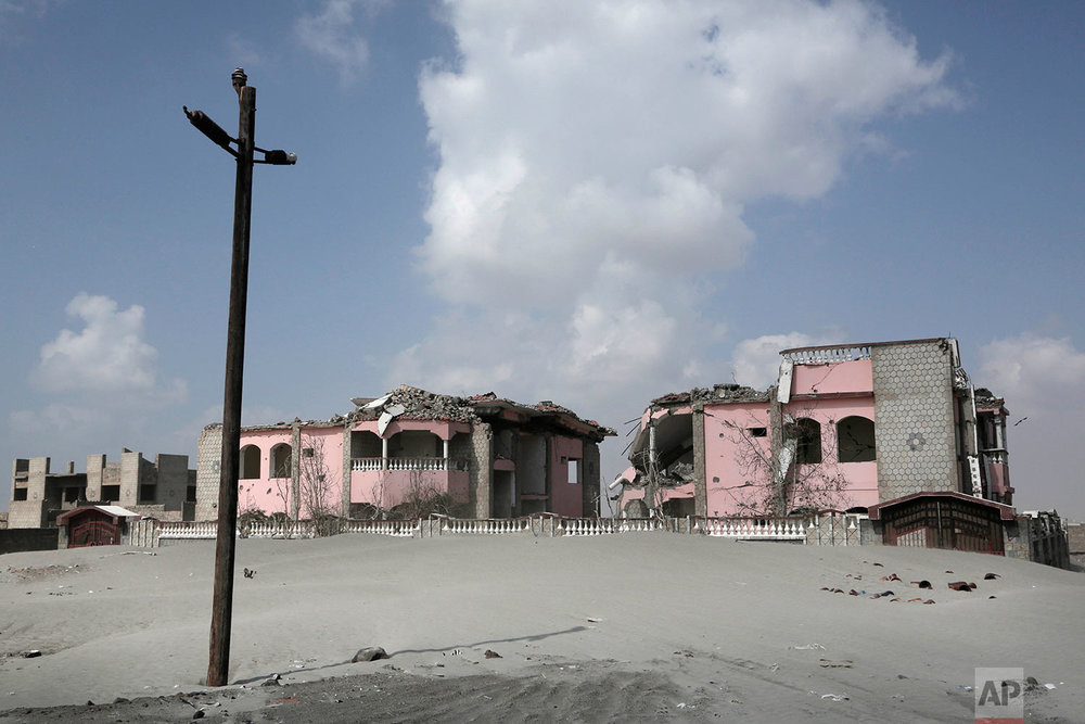 This Feb. 15, 2018 photo, shows damaged property due to the war in Abyan, Yemen. Violence, famine and disease have ravished the country of some 28 million, which was already the Arab world's poorest before the conflict began. The conflict pits a U.S.-backed, Saudi-led coalition supporting the internationally recognized government, which has nominally relocated to Aden but largely lives in exile, against rebels known as Houthis. (AP Photo/Nariman El-Mofty)