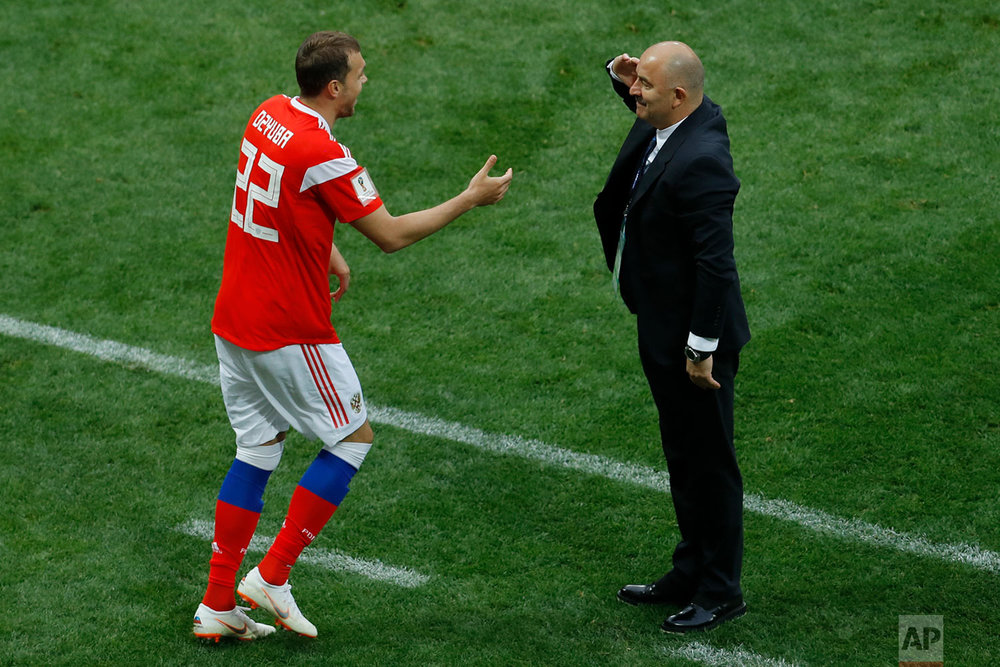 Russia head coach Stanislav Cherchesov salutes Artyom Dzyuba after he scored his side's third goal against Saudi Arabia in the group A match which opened the 2018 soccer World Cup at the Luzhniki stadium in Moscow, Russia, Thursday, June 14, 2018. (AP Photo/Victor Caivano)
