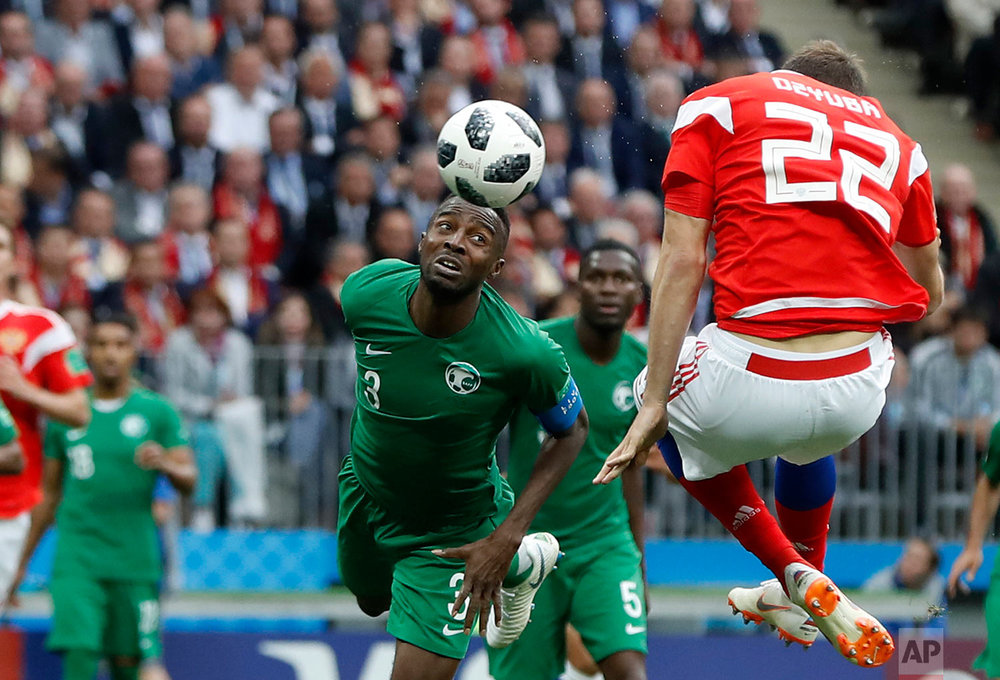 Russia's Artyom Dzyuba, right, scores his side's third goal during the group A match between Russia and Saudi Arabia which opens the 2018 soccer World Cup at the Luzhniki stadium in Moscow, Russia, Thursday, June 14, 2018. (AP Photo/Pavel Golovkin)