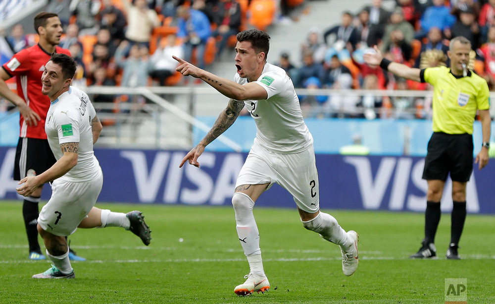 Uruguay's Jose Gimenez celebrates after scoring his side's opening goal during the group A match between Egypt and Uruguay at the 2018 soccer World Cup in the Yekaterinburg Arena in Yekaterinburg, Russia, Friday, June 15, 2018. (AP Photo/Natacha Pisarenko)