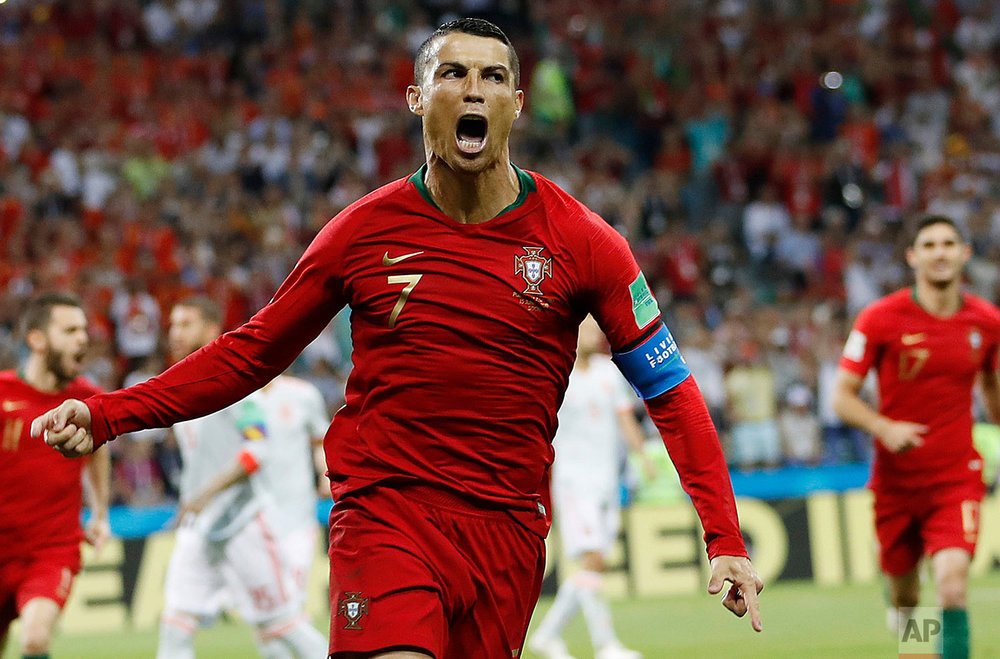Portugal's Cristiano Ronaldo celebrates his side's opening goal during the group B match between Portugal and Spain at the 2018 soccer World Cup in the Fisht Stadium in Sochi, Russia, Friday, June 15, 2018. (AP Photo/Francisco Seco)