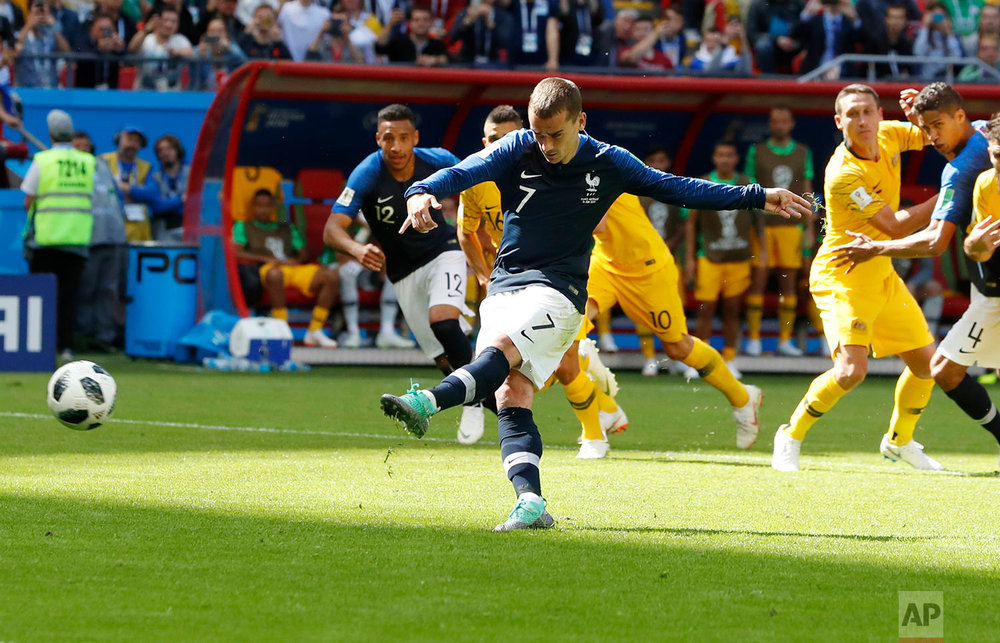 France's Antoine Griezmann scores the penalty goal during the group C match between France and Australia at the 2018 soccer World Cup in the Kazan Arena in Kazan, Russia, Saturday, June 16, 2018. (AP Photo/Darko Bandic)