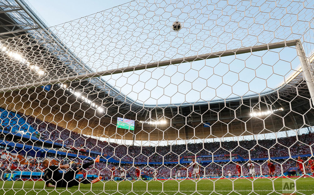 Denmark goalkeeper Kasper Schmeichel, left, looks on as Peru's Christian Cueva fails to score from the penalty spot during the group C match between Peru and Denmark at the 2018 soccer World Cup in the Mordovia Arena in Saransk, Russia, Saturday, June 16, 2018. (AP Photo/Martin Meissner)