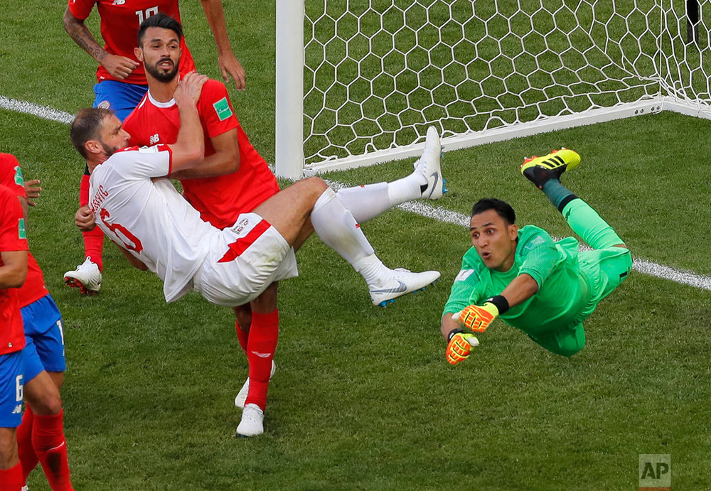 Serbia's Branislav Ivanovic, left, tries to score past Costa Rica goalkeeper Keylor Navas during the group E match between Costa Rica and Serbia at the 2018 soccer World Cup in the Samara Arena in Samara, Russia, Sunday, June 17, 2018. (AP Photo/Vadim Ghirda)