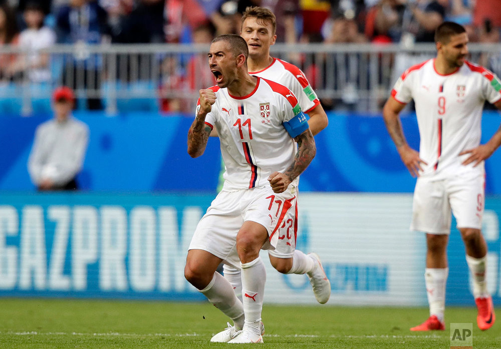 Serbia's Aleksandar Kolarov celebrates after scoring the opening goal during the group E match between Costa Rica and Serbia at the 2018 soccer World Cup in the Samara Arena in Samara, Russia, Sunday, June 17, 2018. (AP Photo/Mark Baker)