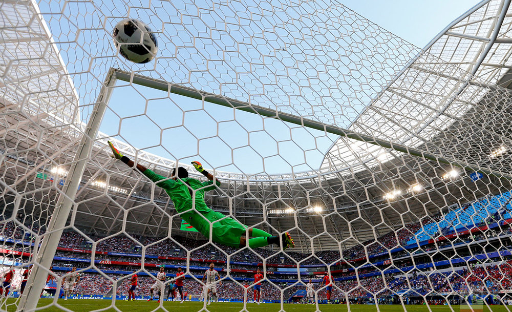 Costa Rica goalkeeper Keylor Navas fails to stop Serbia's Aleksandar Kolarov scoring the opening goal during the group E match between Costa Rica and Serbia at the 2018 soccer World Cup in the Samara Arena in Samara, Russia, Sunday, June 17, 2018. (AP Photo/Natacha Pisarenko)