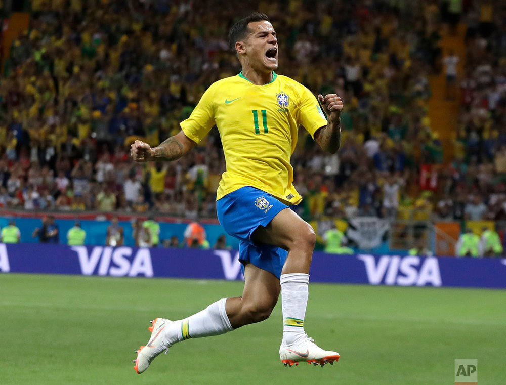 Brazil's Philippe Coutinho celebrates with teammates after scoring his side's opening goal during the group E match between Brazil and Switzerland at the 2018 soccer World Cup in the Rostov Arena in Rostov-on-Don, Russia, Sunday, June 17, 2018. (AP Photo/Themba Hadebe)