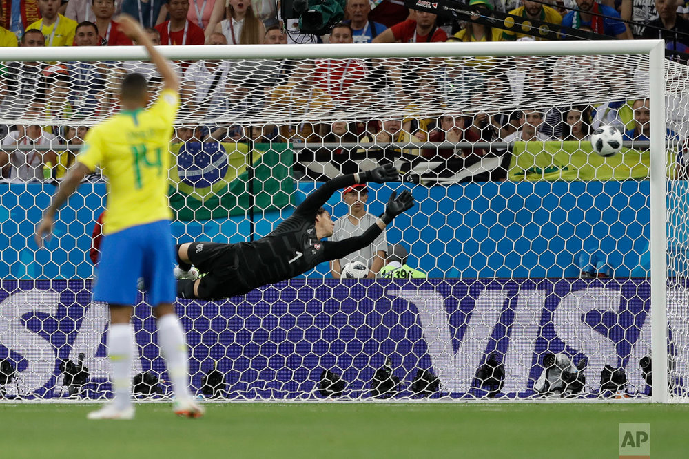Switzerland goalkeeper Yann Sommer can't stop a shot from Brazil's Philippe Coutinho during the group E match between Brazil and Switzerland at the 2018 soccer World Cup in the Rostov Arena in Rostov-on-Don, Russia, Sunday, June 17, 2018. (AP Photo/Andre Penner)